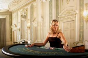 Female croupier at Blackjack table in casino, portrait